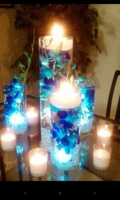 blue orchids submerged in vases filled with water and floating candles on the top for an adorable wedding reception centerpiece that's the idea I'm using for my wedding decorations Wedding Reception Centerpieces, Wedding Table, Wedding Decorations, Table Decorations, Reception Table, Reception Ideas, Trendy Wedding, Our Wedding, Dream Wedding