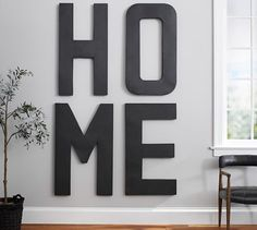http://www.potterybarn.com/products/oversized-hanging-letter-wall-art/?cm_ven=TellApart
