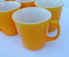 Corelle Citrus Yellow-Orange Flared Mugs - Set of 8. via Etsy.