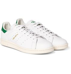 Since its debut as a tennis shoe in the '70s, <a href='http://www.mrporter.com/mens/Designers/Adidas_Originals'>adidas Originals</a>' 'Stan Smith' sneakers have graced the feet of some of the most stylish men and women. This pair sports classic green heel tabs and gold designer emblems on the side. Wear them with tailored trousers for a considered high-low mix.