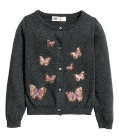 Fine-knit cardigan in soft cotton with buttons down the front, long sleeves and rib-knit cuffs and hem.