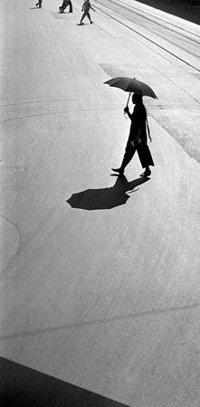 Fan Ho Braided Woman Crossing The Living Theatre ::  http://www.modernbook.com/fanho/living_theatre/images.htm