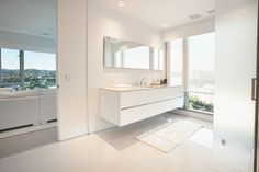 Floating cabinetry and back lit floating mirror | Usual House