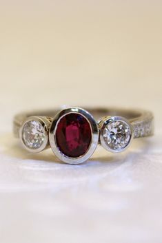 Diamonds and a radiant ruby. An elegant pair in this custom designed ring from Wong Ken's. Birthstone Gems, Ring Watch, Custom Jewelry Design, Pear Shaped Diamond, Quality Diamonds, Fine Jewelry, Jewellery, Beautiful Rings, Garnet