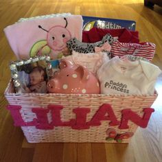 new born baby gift basket. gifts from Macy's and Home Goods. Basket from Home Goods. Letters from Joann's.