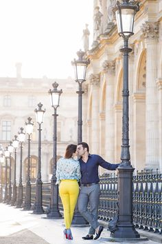 The Louvre Museum has plenty of nearby spots where you can get photos that are complementary to the pyramid. We love the lanterns as in this photo. As you can see, the yellow pants and the red heels of her Louboutin pop beautifully. Dress accordingly.