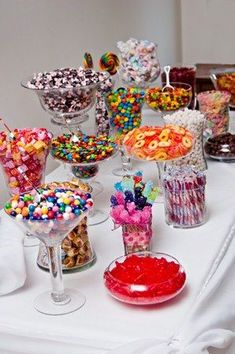 Candy buffet ... a look at different containers and vases for your candy bar. For wedding planning, destination wedding planning and honeymoons call PJ 888-696-4202
