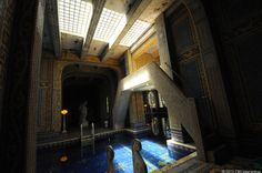Hearst Castle - Roman Pool Complex - Light flows through glass bricks from above into the Roman Pool, creating a contrast with the indoor area, including this bridge which goes up to a diving platform.
