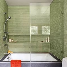 Shapely Tile-Geometric shapes -- a square tub, rectangular tile and shelf niche, a round showerhead and controls -- are characteristic of contemporary design. A glass door helps this tub-shower combo feel open and inviting, while the tiled surround protects the walls.