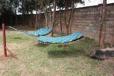 Hammock idea for the backyard - love the double hammock idea. No more hammock'ing alone!