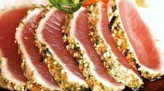 Seared Ahi Tuna. Dinner a few nights ago. Insanely easy and delicious. I made a little extra of the marinade and used it as a dipping sauce.