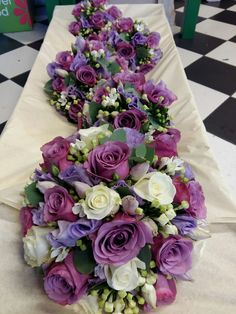 purple rose, lilac lizzianthus and ivory rose wedding flowers