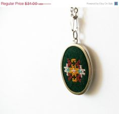 Hand embroidered necklace cross stitch on dark green by skrynka, $24.80