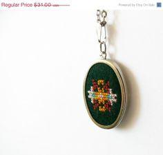 Hand embroidered necklace cross stitch on dark green by skrynka, $24.80