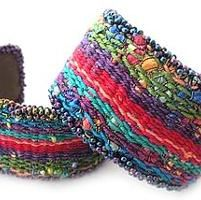 You have to see Tapestry/Bead Cuff Bracelet on Craftsy! - Looking for weaving project inspiration? Check out Tapestry/Bead Cuff Bracelet by member Claudia Chase. Weaving Textiles, Weaving Art, Weaving Patterns, Tapestry Weaving, Loom Weaving, Fiber Art Jewelry, Textile Jewelry, Fabric Jewelry, Jewellery