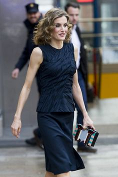 Pin for Later: Queen Letizia Took Her Monochrome Look to a Whole New Level — Thanks to 1 Tiny Detail She Gave Her Look Some Flair With a Subtle Peplum Top And a colorful clutch!