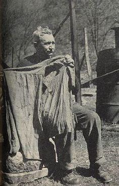 """Joe D. Hatfield holds up the shirt worn by his uncle Ellison on the day he was killed by three McCoys. There are 26 knife holes in it. The three McCoys were killed the same day; one of them, Little Randall, 15, was told to beg for his life but replied, """"Go to hell,"""" and was shot."""