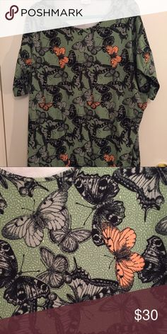 Butterfly Irma This is a large Irma with mint green background and black and peach butterflies. LuLaRoe Tops Tunics