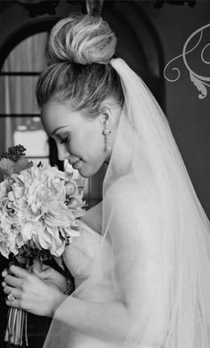 I love Hilary Duff's wedding hair bun... I think I might consider this, so chic yet simple, leaving all the attention to the face and dress.