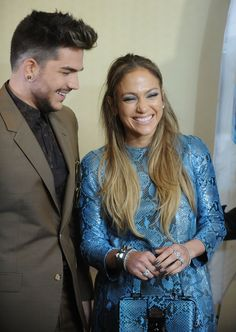 "We hear that Adam is a funny guy. Adam Lambert and Jennifer Lopez share a laugh during an ""American Idol"" event on Sept. 17 in Brooklyn, N.Y."