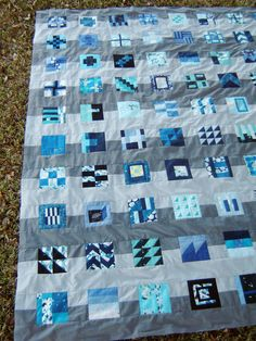 """City Planner"" quilt, I don't think I like this pattern, but I like the idea of mini blocks, all different but the same color family, set wide apart against a background. Would be an interesting way to make a ""sampler"""