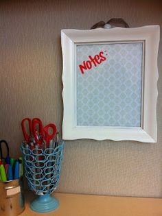 Simple dry erase board: wallpaper, gift wrap etc, inside a picture frame. Glass acts as the white board surface :)