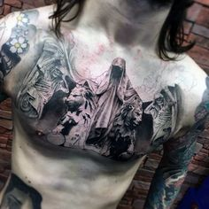 Male Chest Hooded Man And Lions Tattoo