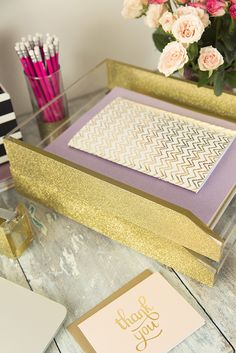 """Who said the office has to be all work and no play? Let your sparkle shine with this stackable letter tray. -Made of heavy cast polished acrylic -Dense gold glitter -Industrial glitter, won't rub off! -Holds all papers and files up to 13"""" x 9 7/8"""" -Non-skid feet"""