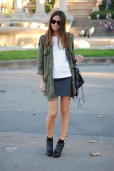 Long green army anorak jacket with a white T and skirt.