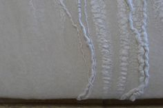 Claudy Jongstra   Mother of Pearl Wallcovering  TWBT Architects  Size 1 panel: 2.50 m x 2.50 m  Material: tussah silk, merino wool