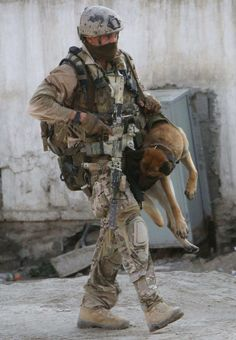 British SBS [Special Boat Service] operator carries a wounded canine comrade to safety. Great work, love It. More