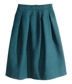 Cute work skirt (too full in the back in real life). Like turquoise and black.