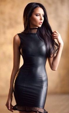Stretch faux leather dress - form fitting with touches of transparent trim at the top and bottom.