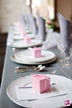 """perhaps we could have the """"5 things you should know about the bride/groom"""" or whatever cards on each plate with the """"match made in heaven match/candy box sitting on top?"""