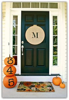 lovelovelove the monogrammed embroidery hoop on the front door! (pumpkins are adorable too!)