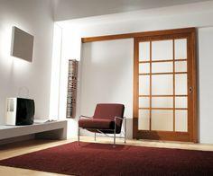 Cloison coulissante en verre ou bois pour la maison moderne modern interior sliding door featuring a cherry wood lattice frame with bianco latte glass panels planetlyrics Gallery