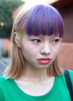 Go for an extra bold look by dyeing your bangs in a contrasting color.