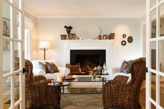 Pottery Barn Seagrass wingback chairs combined with the 2 slipcovered ones.  Like the contrast against the lighter neutrals. Designed by Mahoney Architects & Interiors ~~`