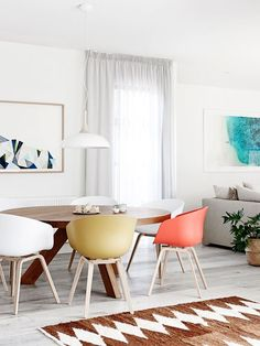 "A neutral backdrop allows shapely Scandinavian-style furnishings to shine. Hay ""About A Chair"" **chairs** from [Cult](http://cultdesign.com.au/