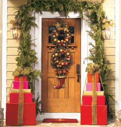 Greet With Gifts   For a gift-giving display, put a brick (or other heavy object) in each bottom box to anchor the decorations. Then wrap the cardboard boxes, stack them, and tie them with a big bow.