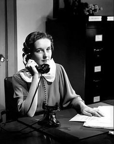 A vintage secretary answers a call. vintage office 1930s 1940s secretary