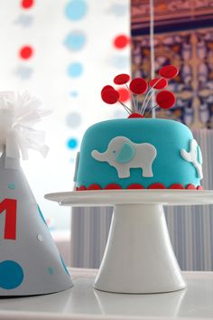 Mod Elephant Can a first birthday party be modern, fun, and sophisticated all at once? Oh yeah! This fondant-covered cake made just for the birthday boy is the perfect combination of sweet and modern. Elephant Birthday Cakes, Unique Birthday Cakes, Elephant Cakes, Baby Birthday Cakes, First Birthday Parties, Boy Birthday, First Birthdays, Elephant Party, Elephant Theme