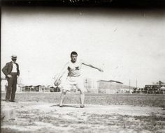 John Flannigan of the Greater New York Irish Athletic Association throwing a discus at the 1904 Olympics.