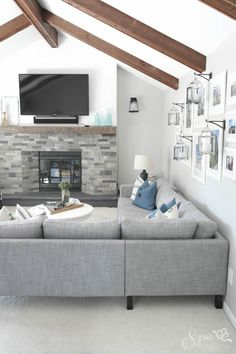 Karlstad sectional, fireplace, lanterns on the wall, exposed beams... it's all good.
