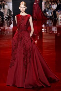 elie saab ruby red mikado gown with fully embroidered lace guipure at front with pleated train, side pockets, and belt
