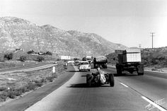 U.S. Grand Prix at Riverside, 1960: Maurice Trintignant, drives his Cooper-Maserati to the race. He finished 15th.