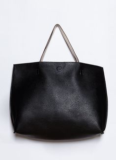 """Black faux leather tote bag featuring contrast cream-colored lining and magnetic snap closure.  18"""" Width, 13"""" Height"""