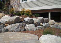 Boulder retaining wall
