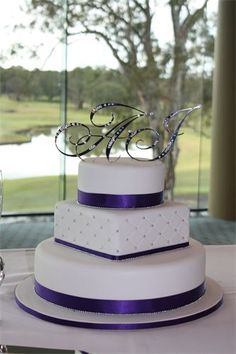 Amanda's Cakes and Invitations - Wedding Cakes- purple white silver round square round wedding cake