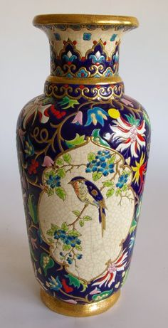 Longwy - Vase of polychrome and gold glazed earthenware, trendy decor with bird in polylobed cartridge, floral field on large blue background.